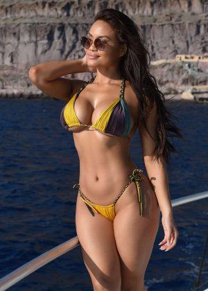 Daphne Joy in Bikini on a yacht in Italy