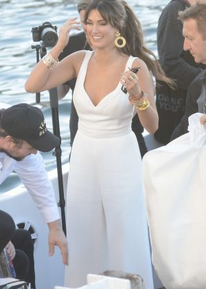 Delta Goodrem in White on a boat in Sydney