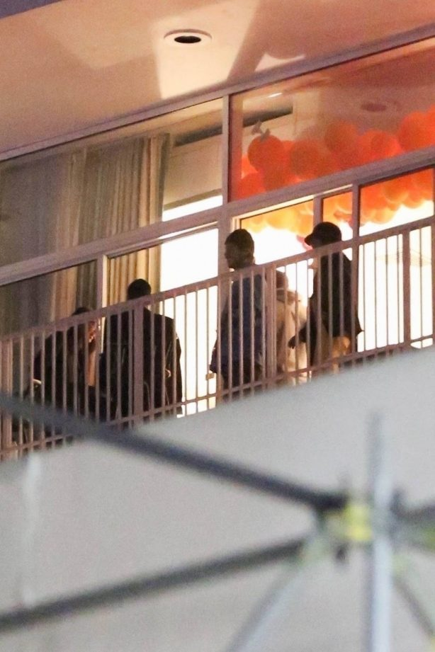 Demi Lovato - Hangs out with a friends on a balcony in Beverly Hills