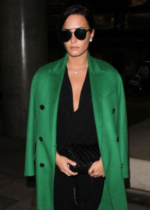 Demi Lovato in Green Coat Arrives to LAX in Los Angeles