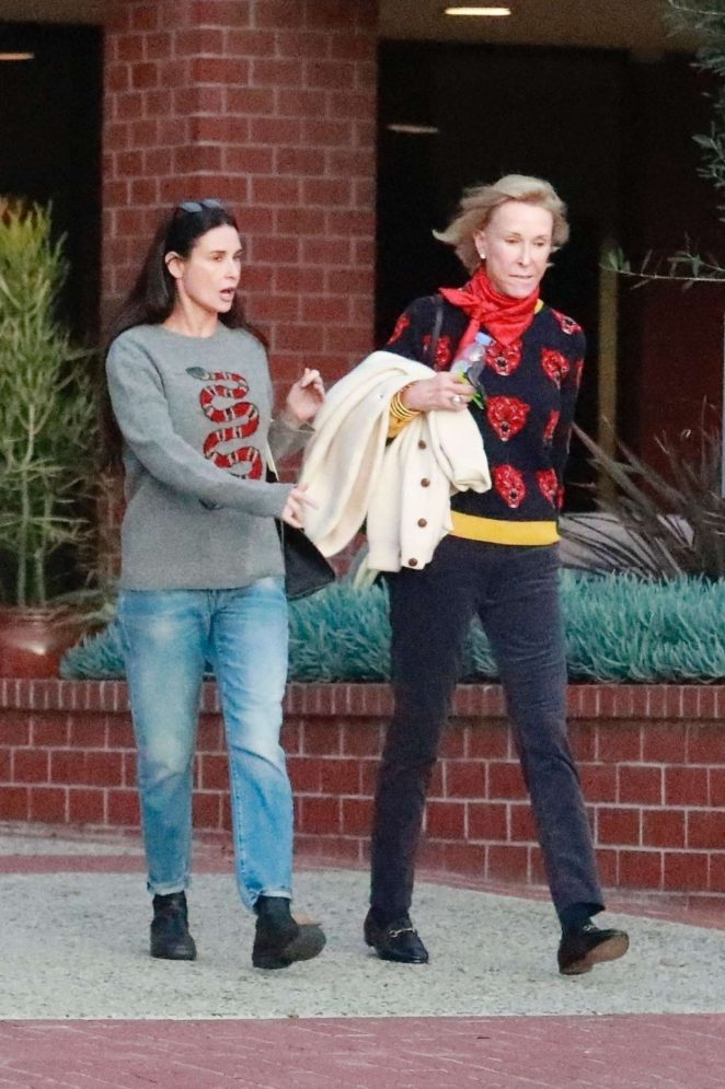 Demi Moore with a friend leaving a health center in LA
