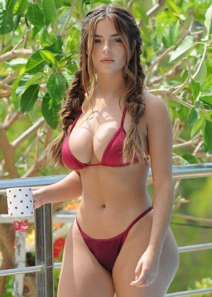 Demi Rose in Red Bikini at the pool in Ibiza