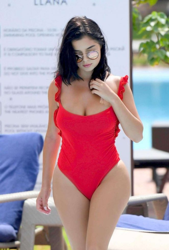 Demi Rose in Red Swimsuit on the pool in Cape Verde