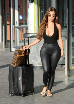 Demi Rose In Tights Arrives At Airport In Ibiza