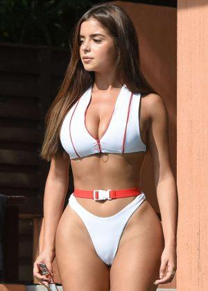 Demi Rose in White Bikini on the pool in Phuket