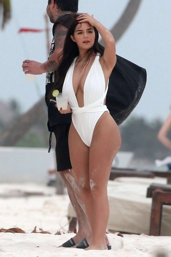Demi Rose in White Swimsuit on the beach in Tulum