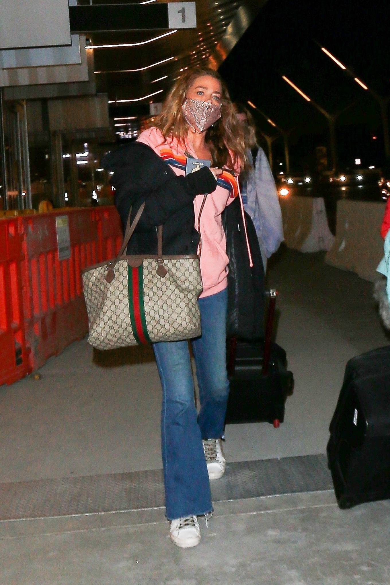 Denise Richards - Seen at LAX