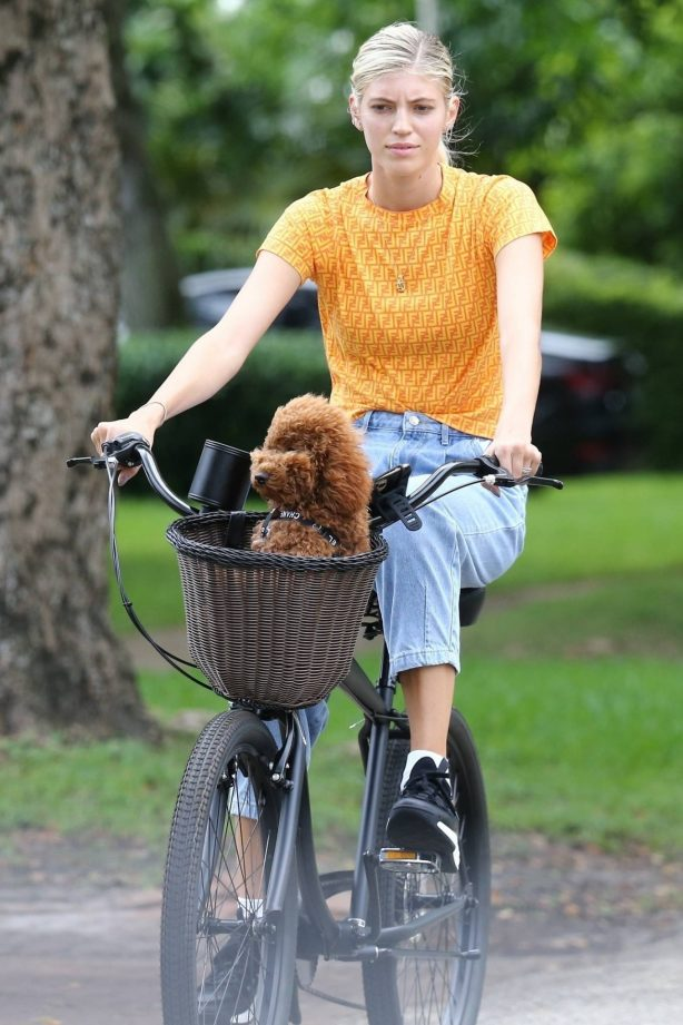 Devon Windsor - Enjoys a bicycle ride with her pooch in Miami