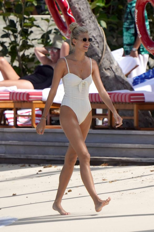Devon Windsor in White Swimsuit at a beach in St Barts
