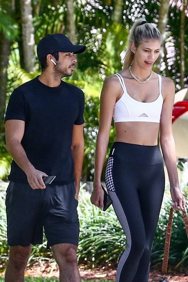 Devon Windsor - Jogging with her husband and dog in Miami