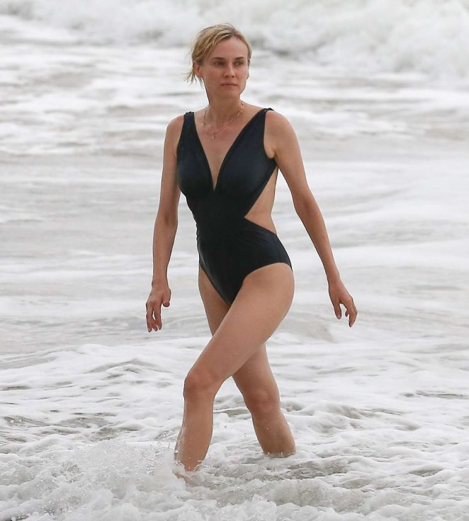 Diane Kruger in Black Swimsuit on the beach in Costa Rica
