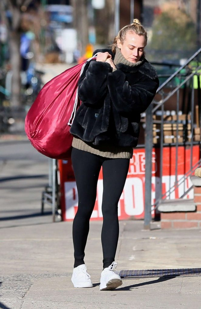 Diane Kruger in Fur Coat and Tights out in NYC