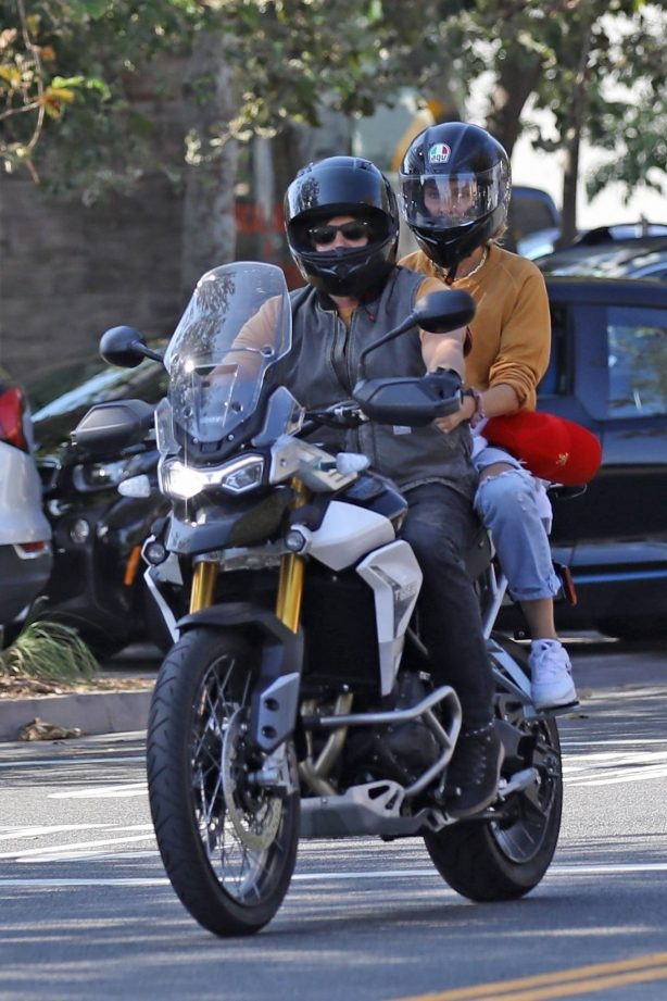 Diane Kruger with Norman Reedus riding a motorcycle in Malibu
