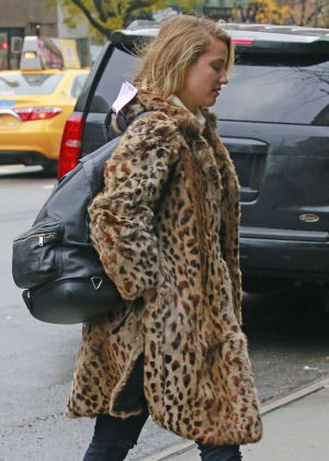 Dianna Agron in a leopard fur jacket in New York
