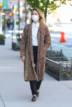 Dianna Agron - In a leopard print overcoat while out in New York