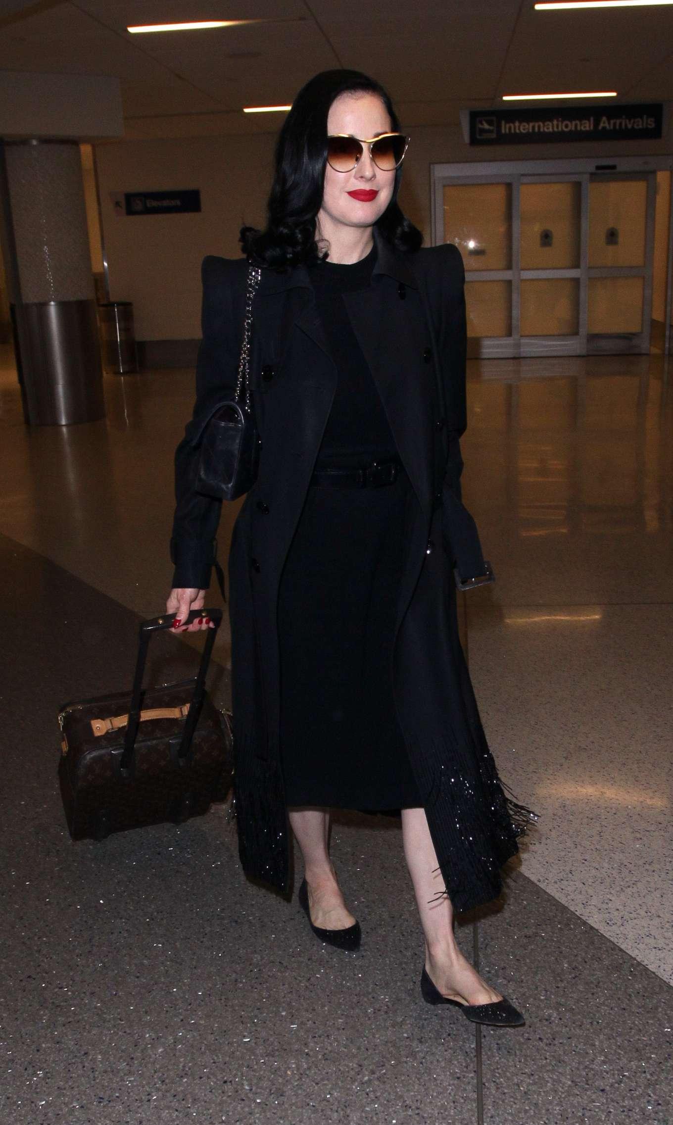 Dita Von Teese - Arrives at LAX International Airport in LA