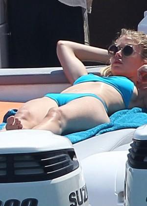 Doutzen Kroes in Blue Bikini on a boat in Ibiza