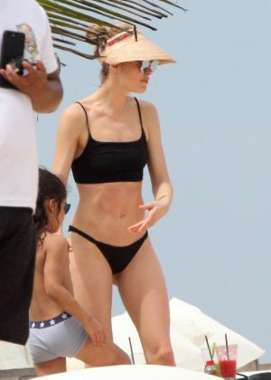 Doutzen Kroes in Black Bikini at the beach in Bahia
