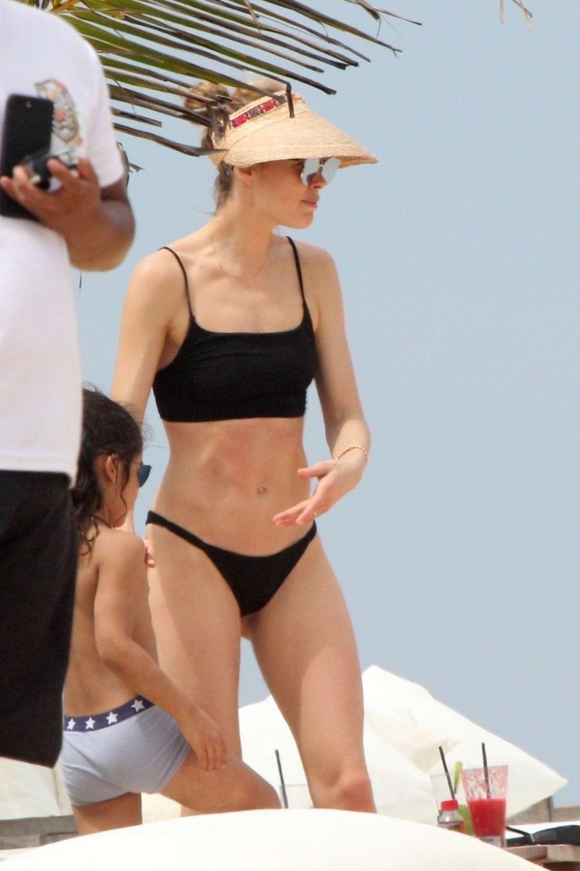 Doutzen Kroes in Black Bikini at the beach in Bahia