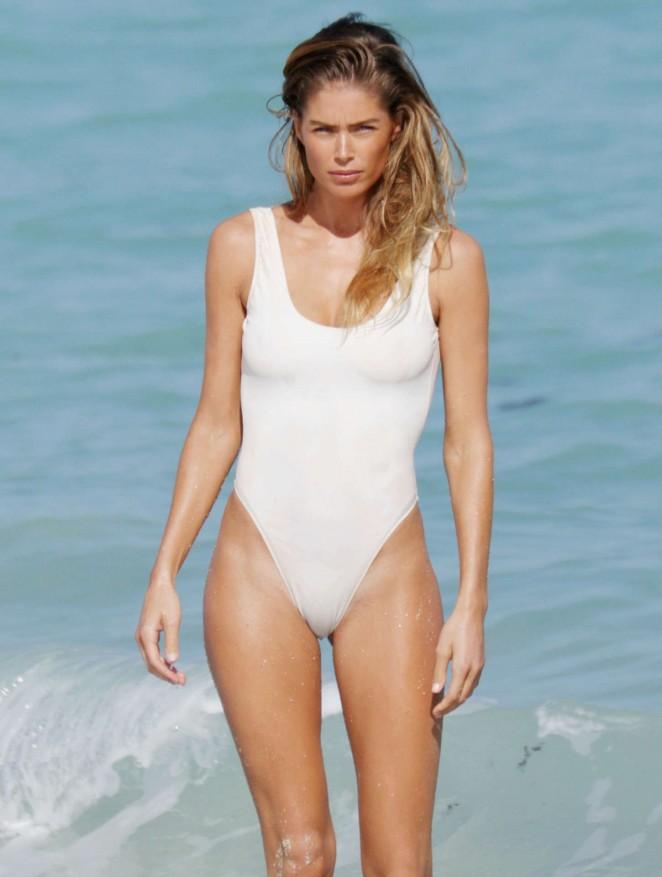 47d945a0c9 Doutzen Kroes in White Swimsuit on Miami Beach – GotCeleb
