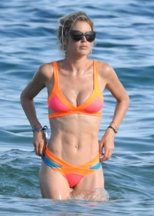 Doutzen Kroes in Orange Bikini in Ibiza