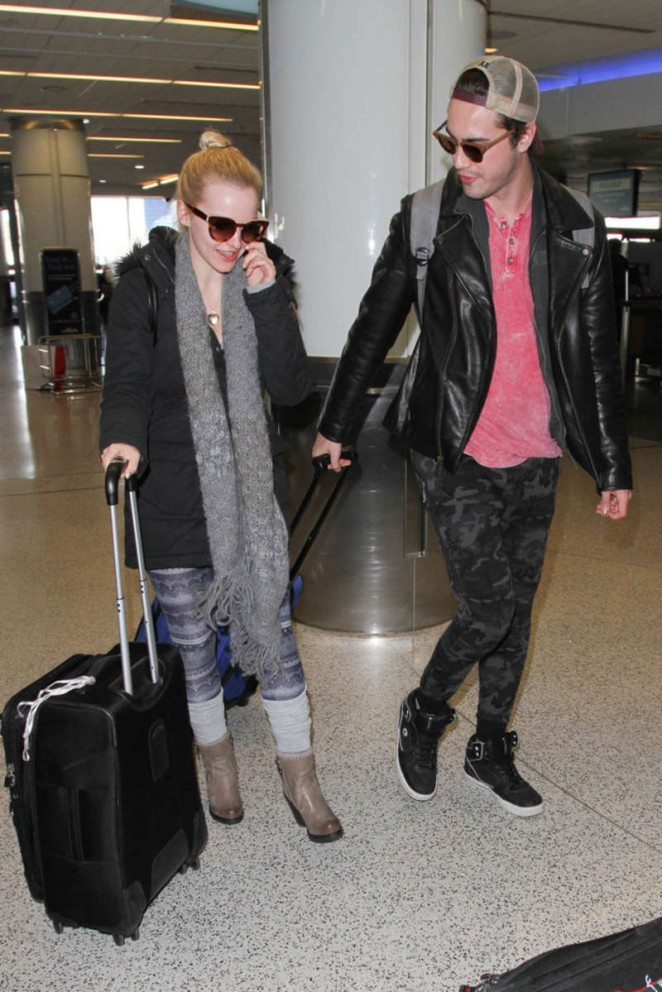 Dove Cameron and Ryan McCartan at LAX Airport in LA