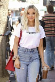 Dove Cameron is seen carrying a red Prada purse in LA