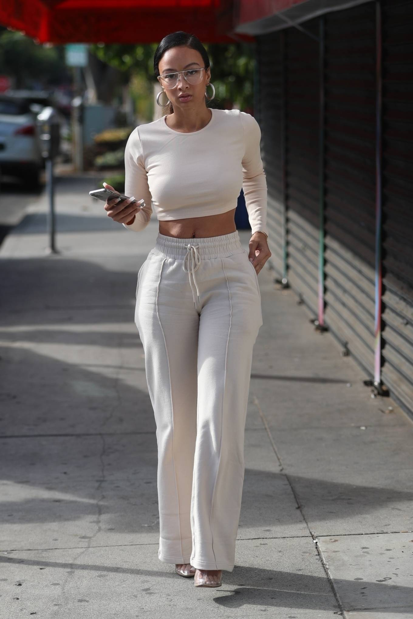 Draya Michele - In all white ensemble on set for her reality show in West Hollywood
