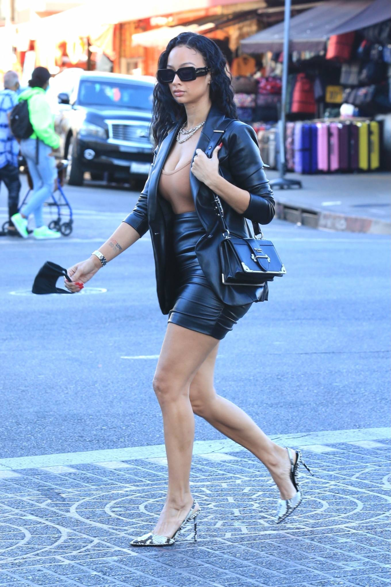 Draya Michele - In leather mini skirt spotted in Downtown Los Angeles