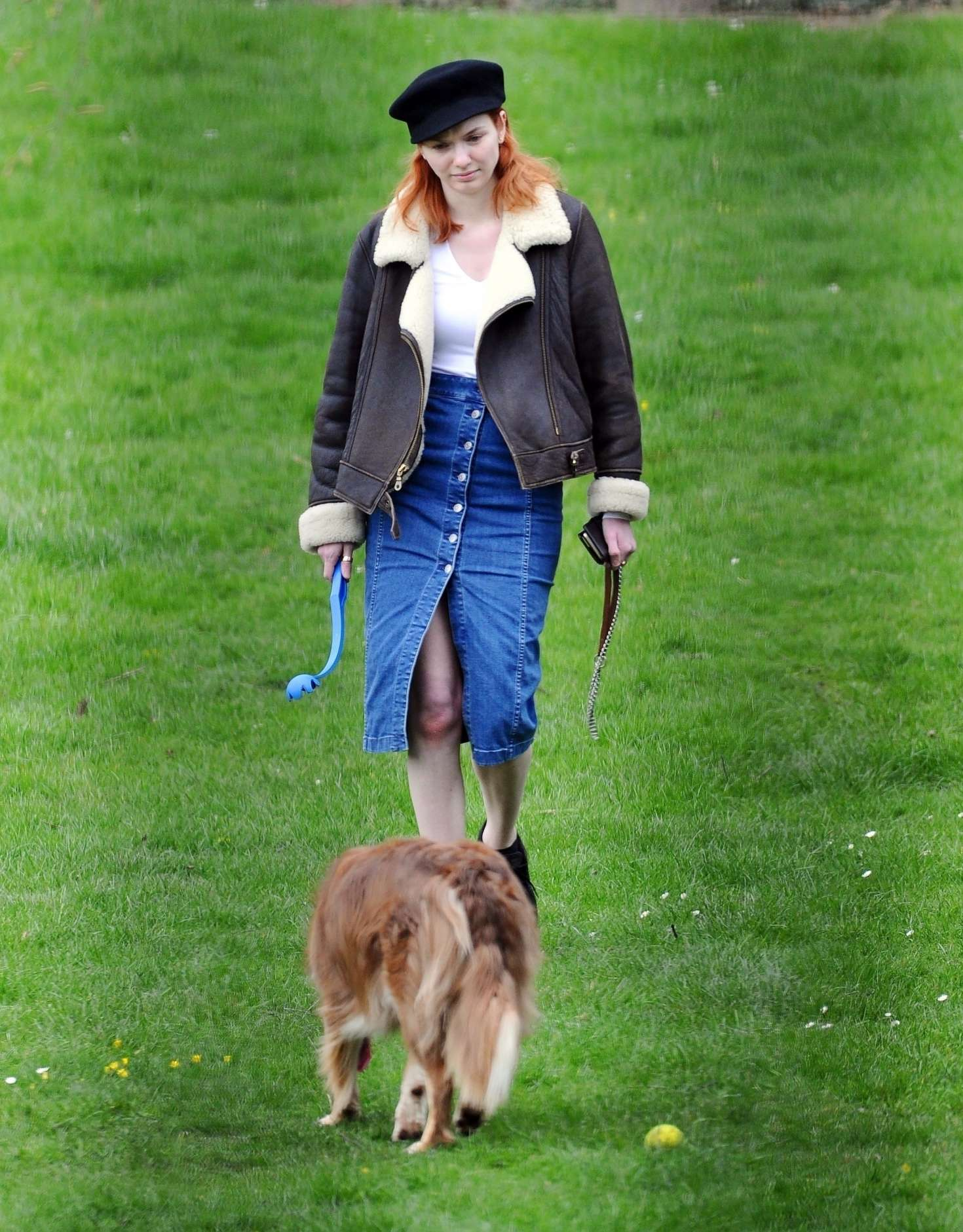 Eleanor Tomlinson - Out with her dog in the park in London