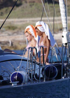 Elena Carriere and Anuthyda Ploypech in Bikini on a boat in Formentera