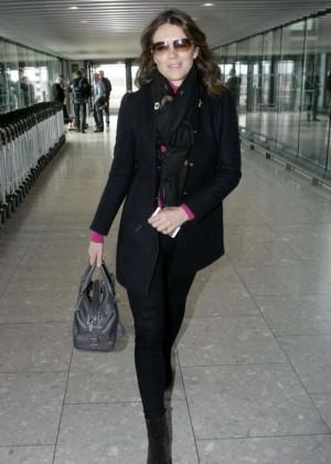 Elizabeth Hurley - Arrives at Heathrow Airport in London