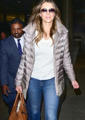Elizabeth Hurley in Jeans arriving back in Los Angeles