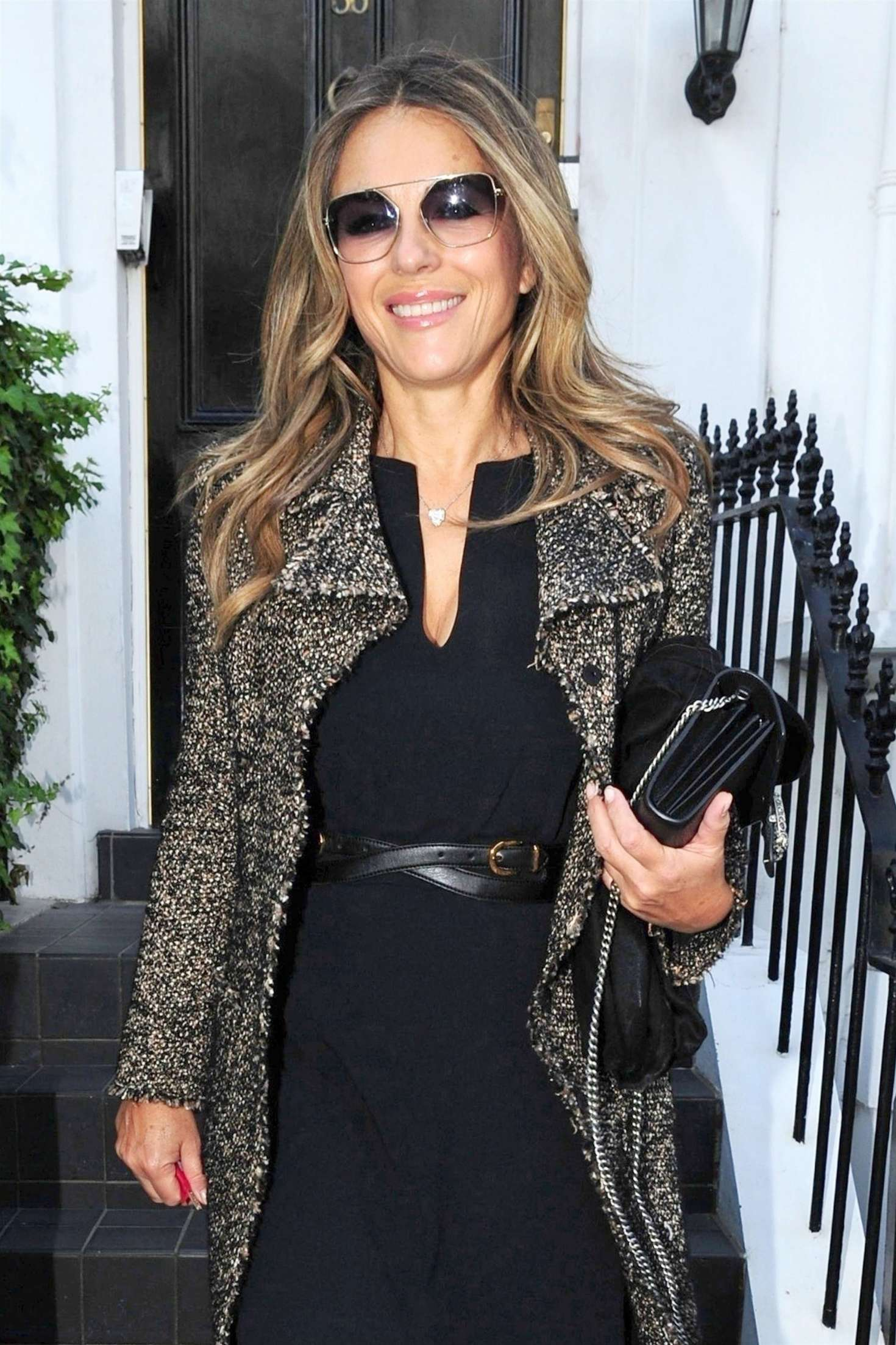 Elizabeth Hurley - Leaving her house and heading to Loulou's restaurant in Mayfair