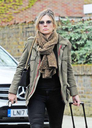 Elizabeth Hurley - Returning home in London