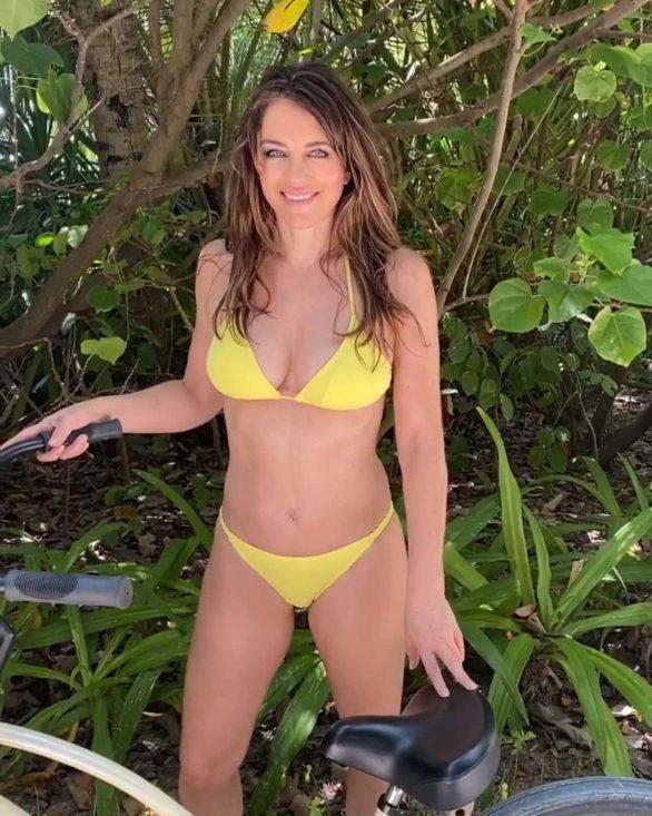Elizabeth Hurley rides bike in a bikini