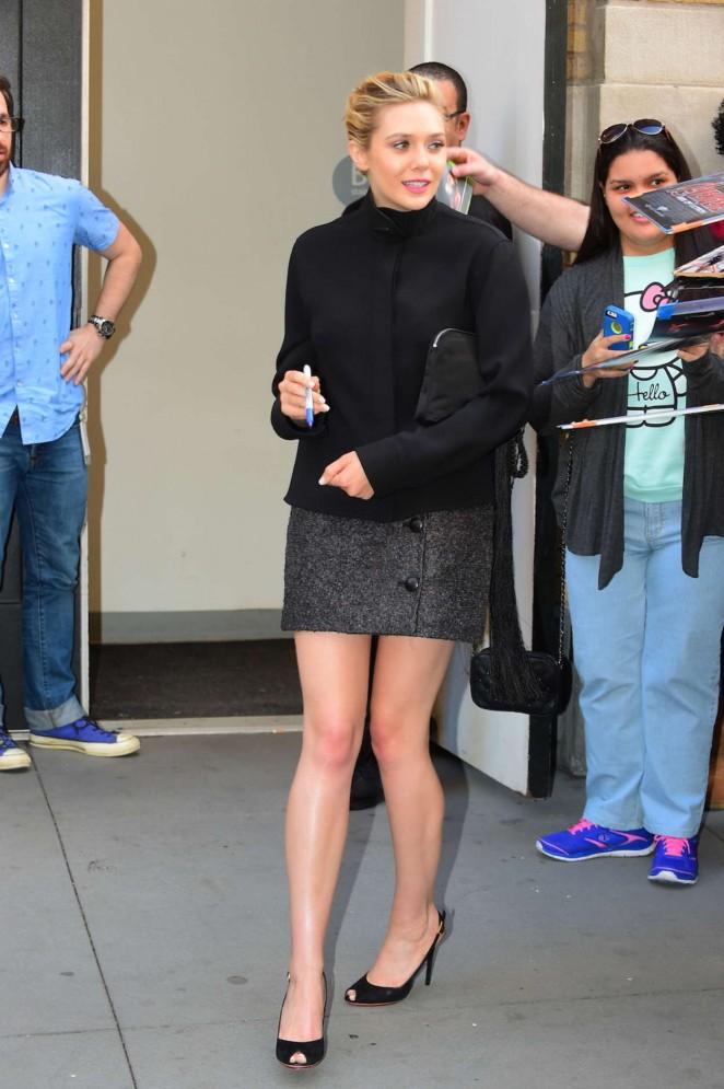 Elizabeth Olsen in Mini Dress Arrives at The Apple Store in Soho