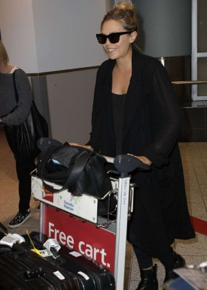 Elizabeth Olsen Arrives at Toronto Airport