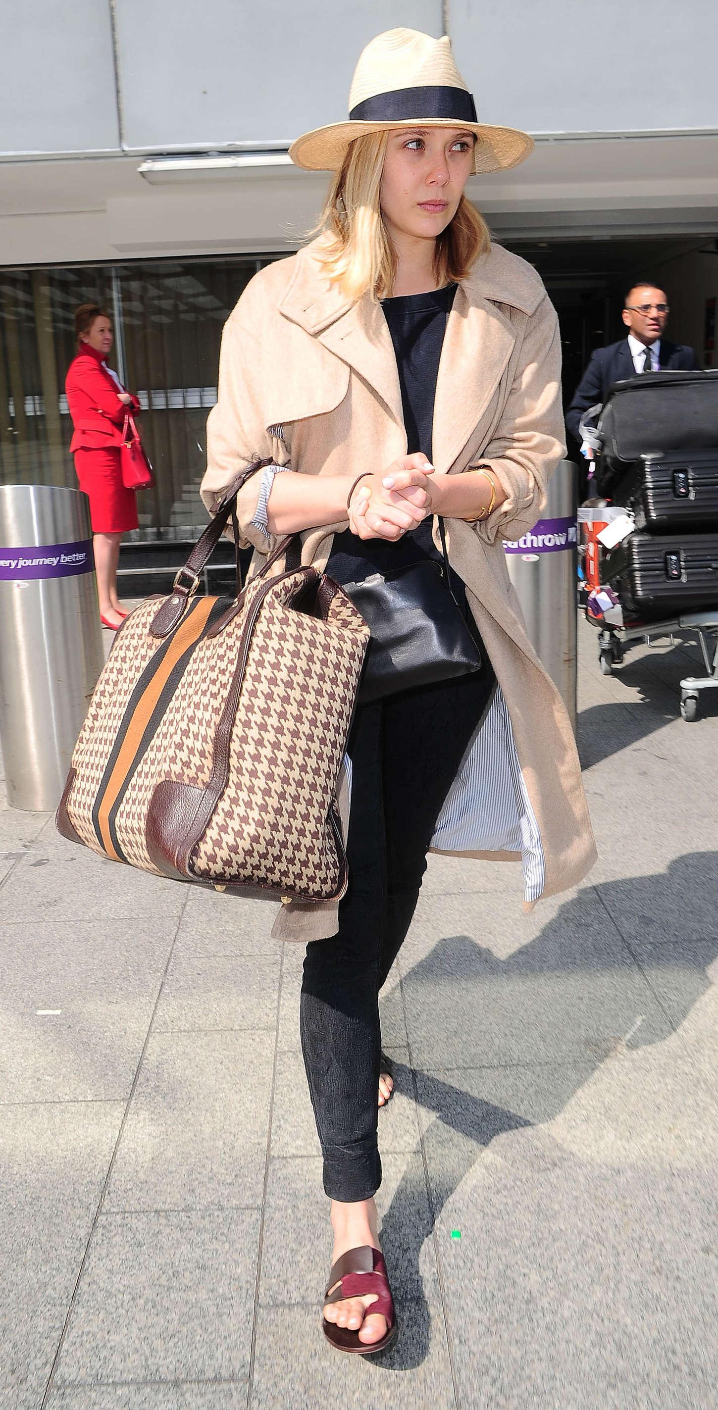 Elizabeth Olsen - Arriving to Heathrow airport in London