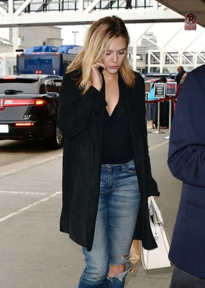 Elizabeth Olsen in Ripped Jeans at LAX Airport in LA