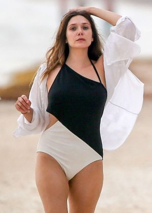Elizabeth Olsen in Black and White Swimsuit at a beach in Mexico