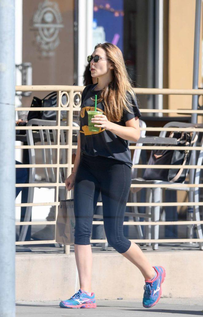Elizabeth Olsen in Tights at Kreation in LA