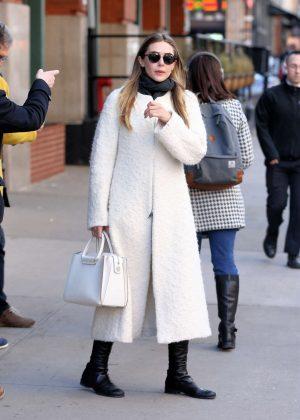 Elizabeth Olsen in White Coat Leaves her hotel in New York City