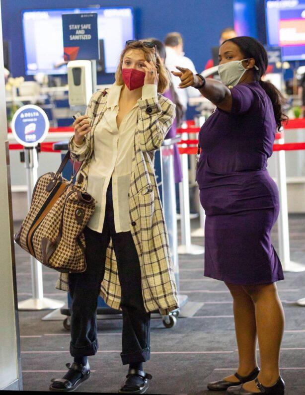 Elizabeth Olsen - seen while flight out of Los Angeles