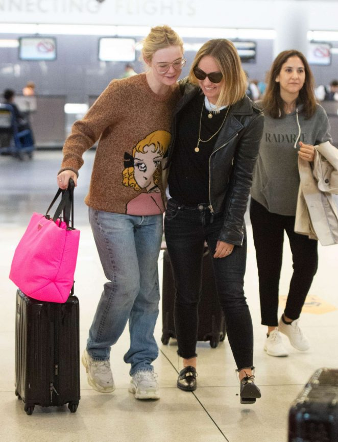 Elle Fanning and Olivia Wilde - Arrive at JFK Airport in NYC