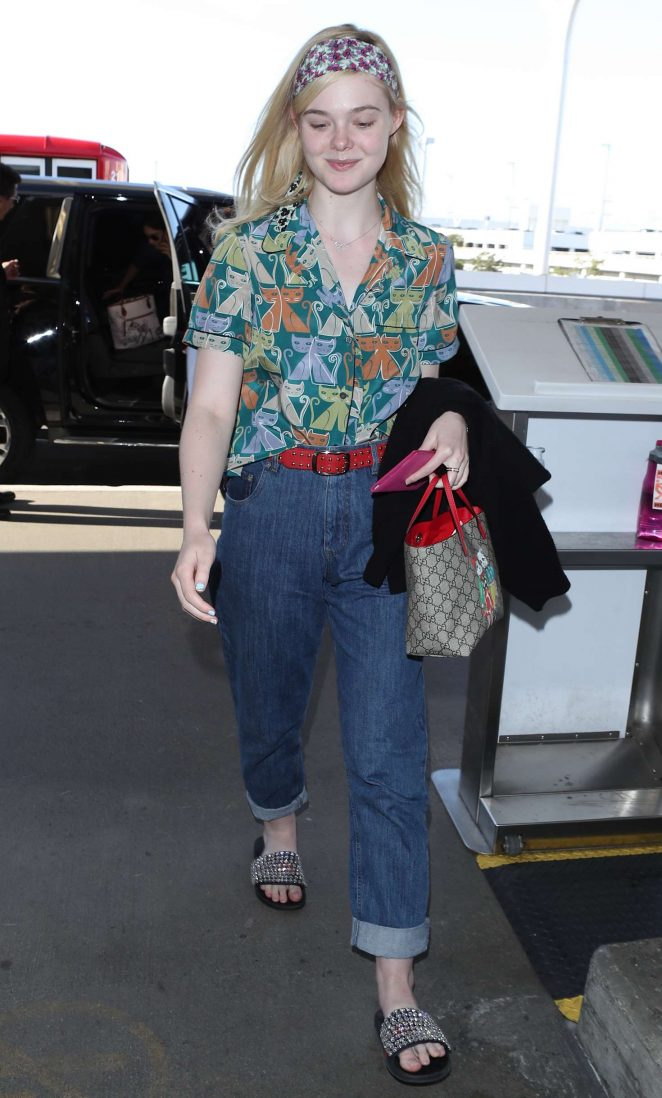 Elle Fanning – Arrives at LAX Airport in LA