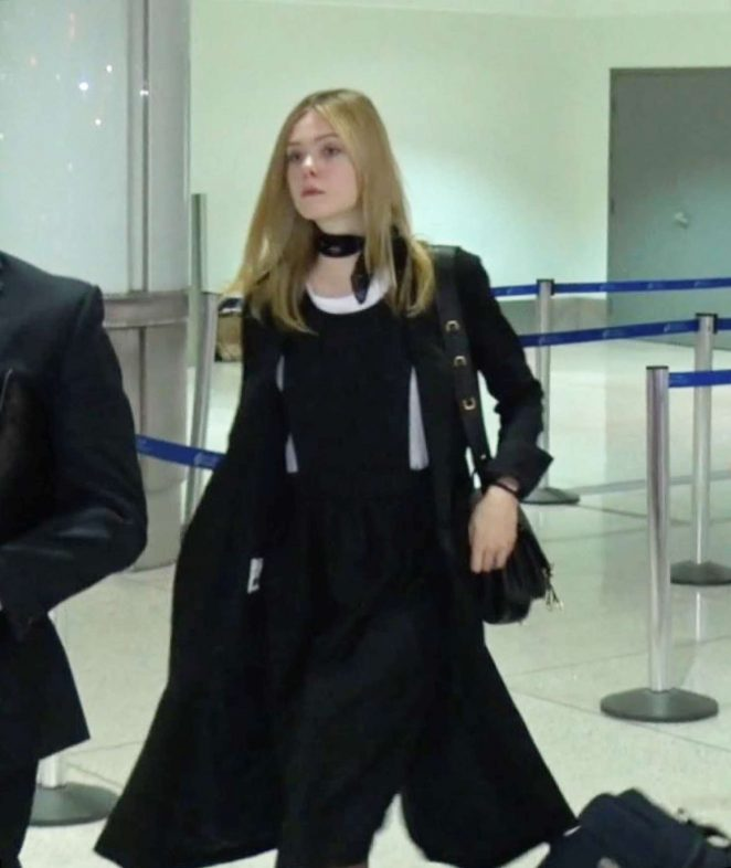 Elle Fanning – Arrives at LAX Airport in Los Angeles