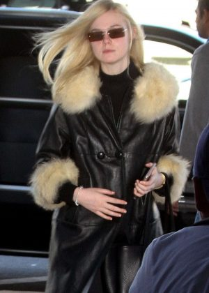 Elle Fanning - Arrives at LAX airport in Los Angeles