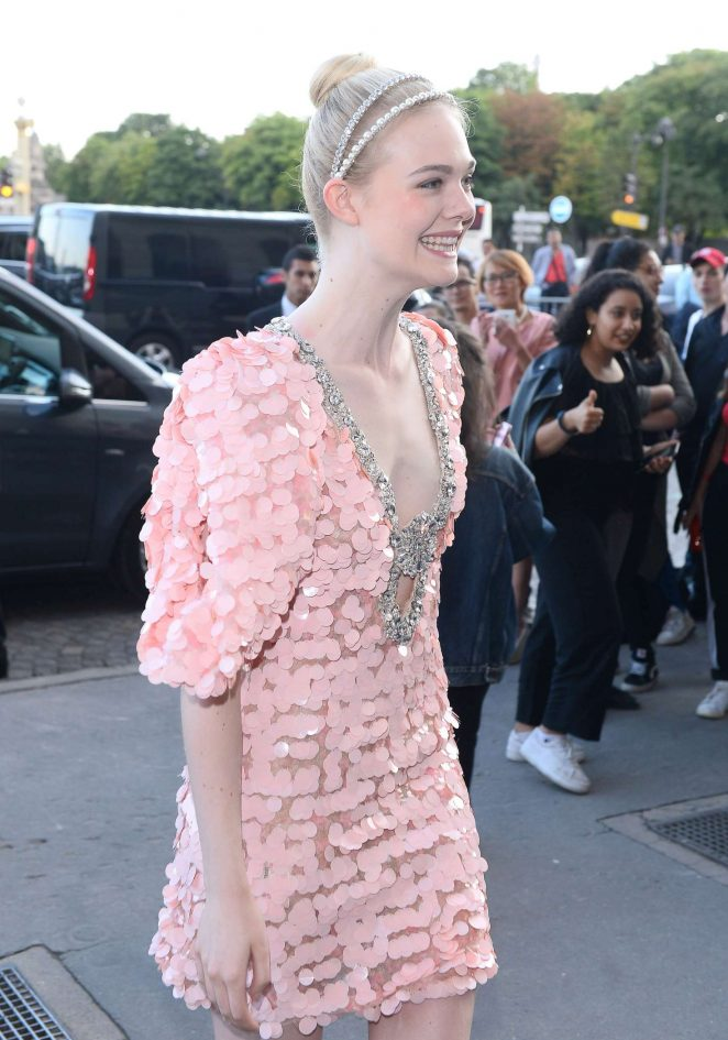 Elle Fanning - Arrives at Mui Mui Fashion Show in Paris