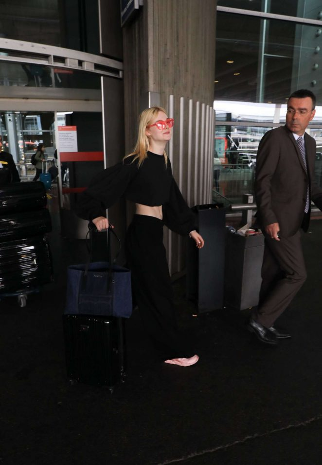 Elle Fanning Arriving at Charles de Gaulle Airport -16